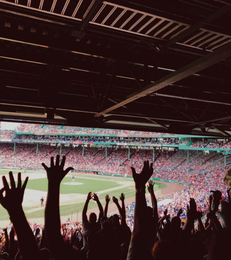 crowds cheering in a boston red sox game | Mobiquity careers in Boston Massachusetts office